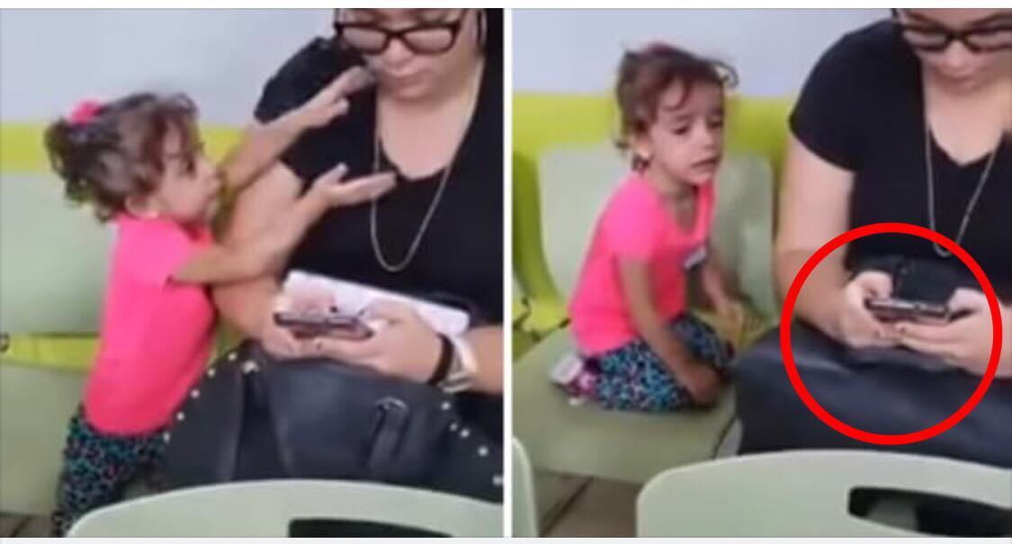 Lille pige prøver forgæves at få kontakt til sin mor, men hun ignorere hende blot og kigger videre på sin mobil - videoen har nu skabt stor forargelse i hele verden